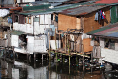 Poverty - squatter homes in Philippines. Squatter homes in the Philippines - shacks in shanty town along heavily polluted Paranaque river in Manila stock photos