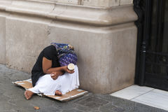 Poverty-stricken female beggar stock image