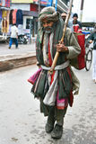 Poverty-stricken man walks in Varanasi Royalty Free Stock Image