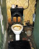 Poverty toilet. Bathroom in a poor home royalty free stock image