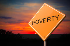 Poverty on Warning Road Sign. Royalty Free Stock Photo