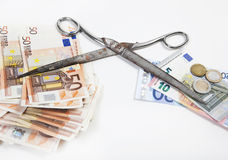 Poverty wealth scissors. The scissors between poverty and wealth goes further apart, illustrated with euros Stock Photo