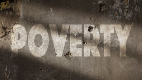 Poverty Written on a Damaged Wall Stock Photos