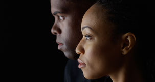 Povos afro-americanos novos no fundo preto Fotos de Stock Royalty Free