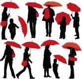 Povos com guarda-chuvas Fotografia de Stock Royalty Free