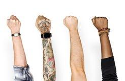 Povos diferentes que mostram seus braços imagens de stock