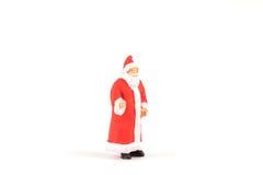 Povos diminutos Santa Claus no fundo com espaço para o texto Foto de Stock