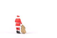 Povos diminutos Santa Claus no fundo com espaço para o texto Imagem de Stock