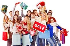 Povos do grupo com venda da placa. imagem de stock royalty free