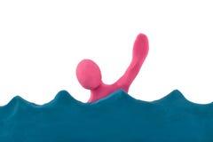 Povos do Plasticine que afogam-se no mar Fotografia de Stock Royalty Free