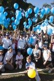 Povos dos membros do pessoal do PMA recolhidos e que comemoram Fotografia de Stock