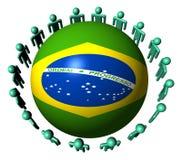 Povos em torno da esfera brasileira da bandeira Fotografia de Stock