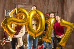 Povos felizes com balões dourados Imagem de Stock Royalty Free