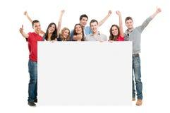 Povos felizes com placa branca Foto de Stock
