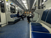 Povos no metro quase vazio fotografia de stock royalty free