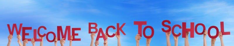 Povos que guardam bem-vindos de volta à escola Fotografia de Stock Royalty Free