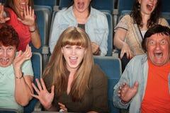 Povos Scared na audiência foto de stock