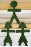 Povos verdes em uma pilha dos livros Fotografia de Stock Royalty Free