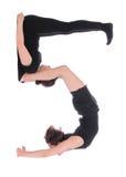 Povos vestidos preto que formam o número cinco 5 Imagens de Stock Royalty Free