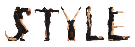 Povos vestidos preto que formam a palavra do ESTILO Fotos de Stock Royalty Free