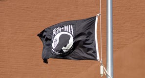 POW MIA Flag. With words, You Are Not Forgotten, waves in the wind across from NJ State Capital Building stock image