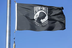 POW/ MIA flag in Brooklyn. BROOKLYN, NY - OCTOBER 20 :POW/ MIA flag in Brooklyn on October 20, 2013. The POW/MIA flag is a symbol of US military personnel taken royalty free stock images