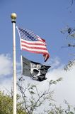 POW MIA. A POW MIA flag flying below the United States flag. The POW MIA flag expresses citizen concern over American military personnel taken as prisoners of stock photos