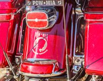 POW MIA Themed Motorcycle Customization. Unique artful POW MIA themed customization on a crimson red motorcycle Stock Photography