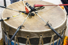 Pow Wow Drum. Indian drum and drum sticks placed in a symbolic manner after the drummers complete their song at a Native American pow-wow stock photo