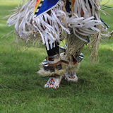 Pow wow feet dancing. American Indian feet dancing with fringe flying at pow wow royalty free stock photo