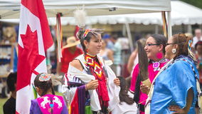 Pow-wow at Fort York, Toronto. Fort York, Toronto - July 25, 2015 - Native American performers dancing at a pow-wow dressed in their traditional costumes stock photos