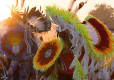 Pow Wow Headdresses. A riot of color in the headdresses worn at a Pow Wow. Feathers, ribbons and beads in red, yellow, orange, blue and white are photographed stock images