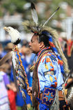 Pow wow man dancer with eagle. American Indian man dancing at a pow wow with an eagle staff stock photo