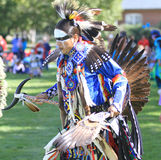 Pow wow man dancer face paint and feathers. American Indian man dancing at a pow wow with bold face paint royalty free stock photos