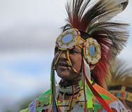 Pow wow man dancer smiling. American Indian man dancing at a pow wow with a big smile stock photography