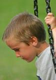 poważna chłopca zamach Zdjęcia Royalty Free