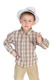 Poważna chłopiec trzyma jego kciuk up Obrazy Royalty Free