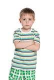 Poważna chłopiec w pasiastej koszula obrazy royalty free