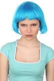 Poważna dziewczyna z błękitny włosiany patrzeć w kamerę z bliska Biały tło Obrazy Royalty Free
