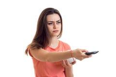 Poważna dziewczyna z tv daleki patrzeć daleko od Zdjęcia Stock