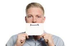 Młody biznesmen przedstawia pustą biel kartę. Fotografia Stock