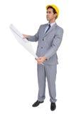 Poważny architekt patrzeje plany myśleć mocno z ciężkim kapeluszem Fotografia Stock