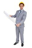Poważny architekt z ciężkiego kapeluszu mienia planami Obrazy Royalty Free