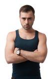 Poważny dorośleć mężczyzna patrzeje kamerę na białym backgro w koszulce Obraz Stock