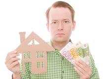 Poważny houseowner z pieniądze fotografia royalty free