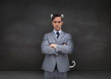 Poważny biznesmen reprezentuje demonu Zdjęcie Royalty Free