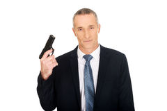 Poważny mafijny agent z pistolecikiem Zdjęcia Royalty Free