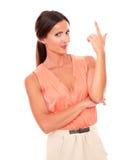 Powabna dama wskazuje up w eleganckiej koszula Obraz Royalty Free