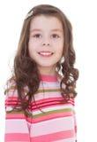 Powabna mała dziewczynka w czerwień paskującej sukni. fotografia stock