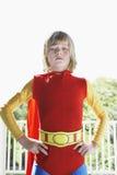 Poważna chłopiec W bohatera kostiumu Indoors Zdjęcie Stock
